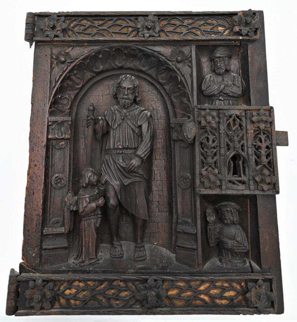 French Iron Mounted 3D Carved Walnut Door Paneldepicting Saint Roch with an angel at his side,two busts to the right, pierced iron...
