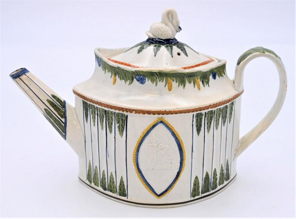 Prattware Leeds Teapotdecorated pearlwork with four colors, swan finial and raised scene on each sideheight 7 1/2 inchesProvenanc...