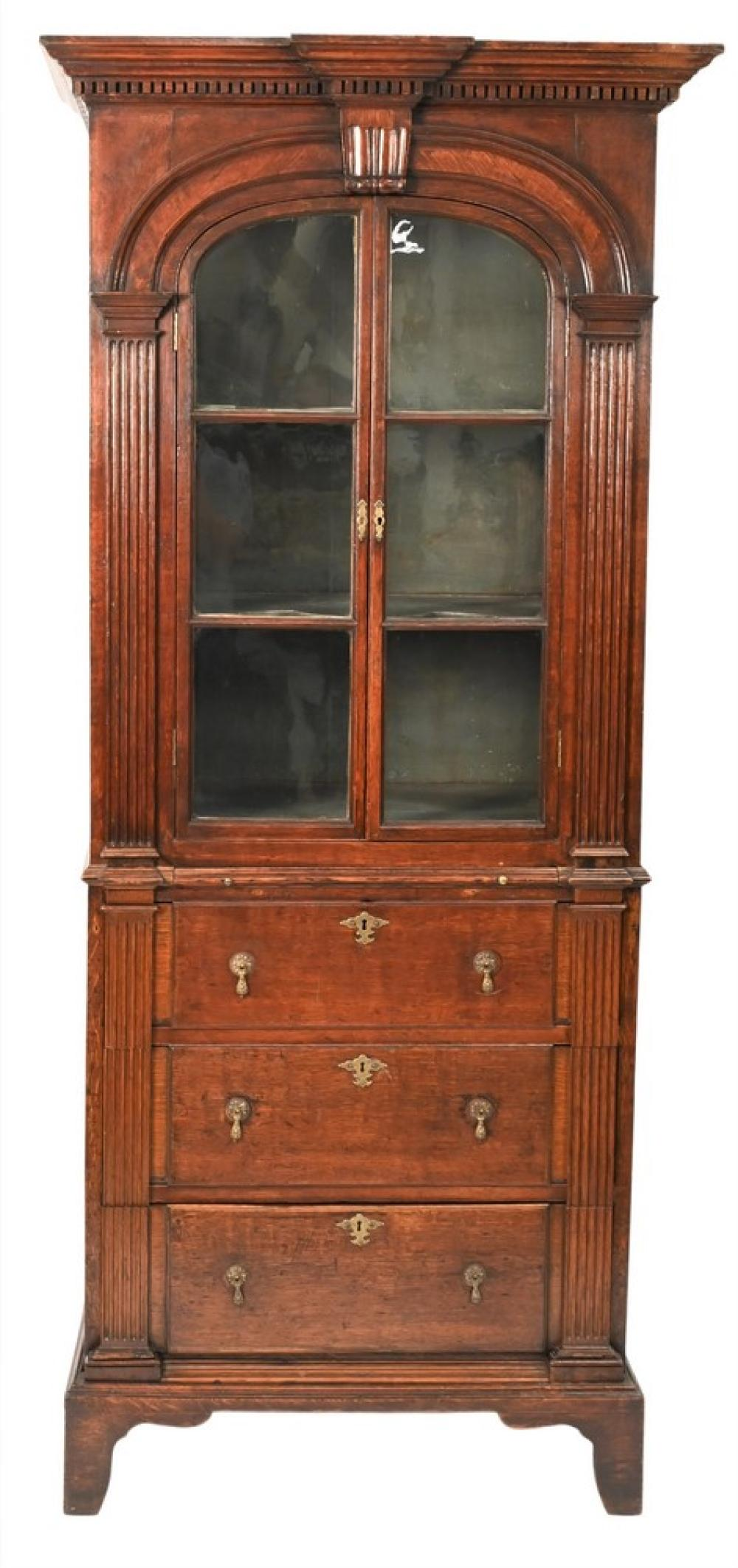 George II Oak Secretaire in Two Parts having dentil molded cornice over two arched doors and flanked by pilasters and lower sect...