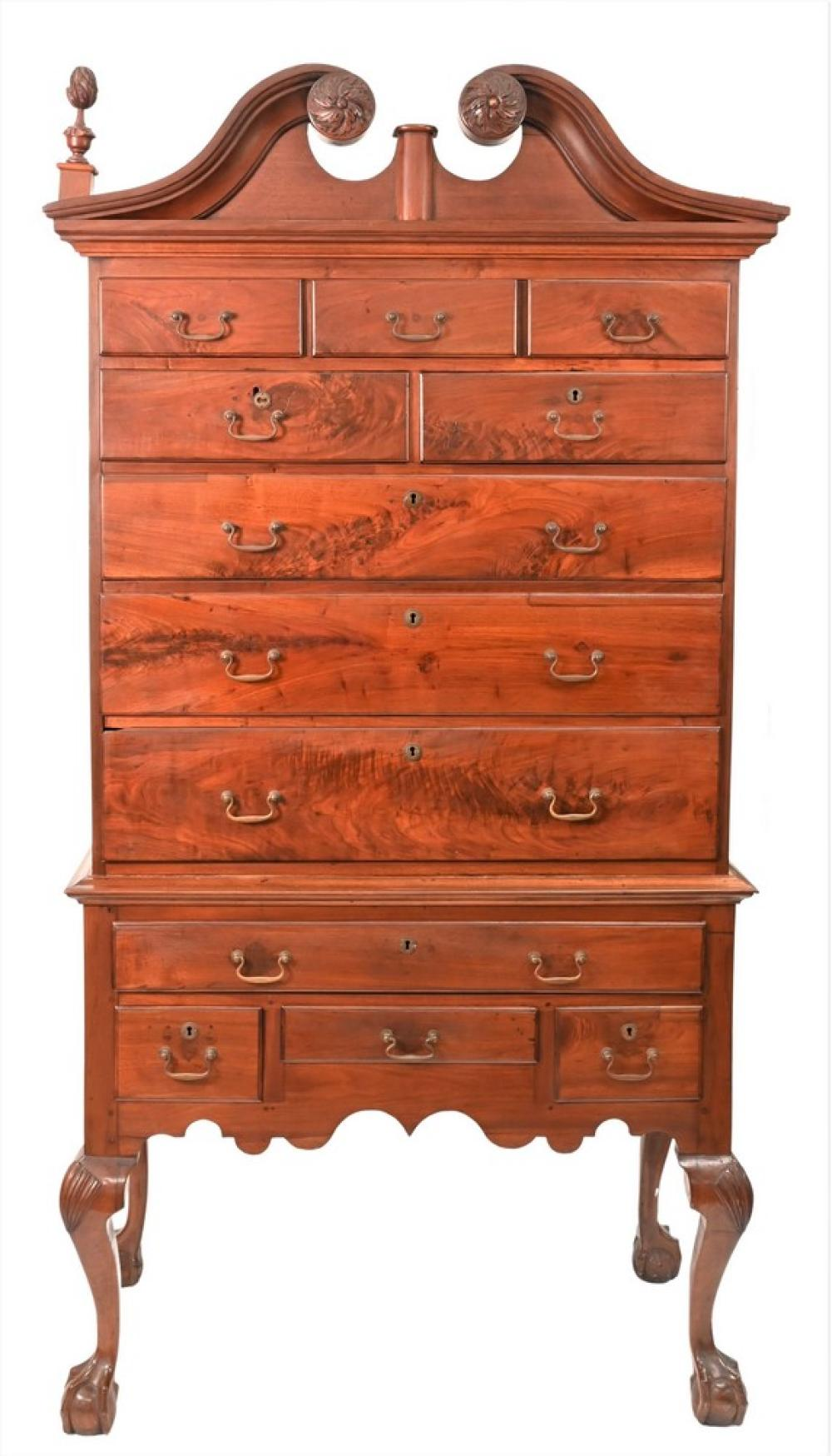 Pennsylvania Walnut Highboyhaving broken arch top over case of drawers set on lower section of four drawers on fan carved cabriole ...