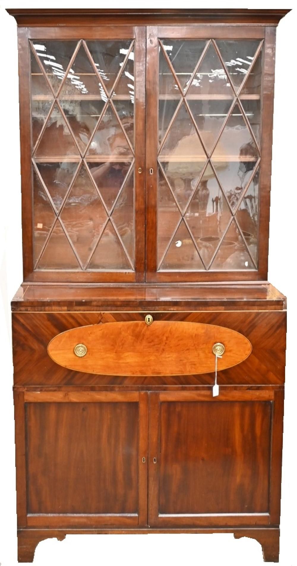 George III Mahogany Secretary Desk in Two Partsupper section with two glazed doorsover lower section with drop front desk over tw...