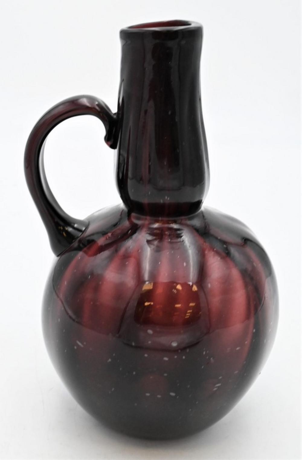 Antique Hand Blown Amethyst Bottlehaving handleheight 9 1/2 inches