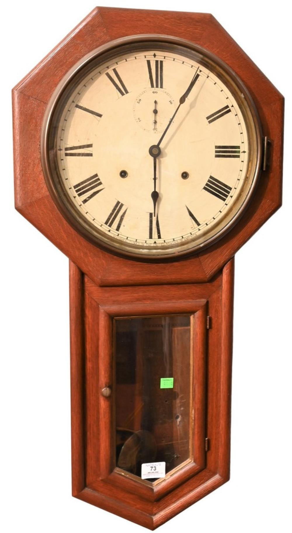 Seth Thomas Schoolhouse Regulator Wall Clock,having oak case with thirty day movement painted metal dial and second hand dial,orig...