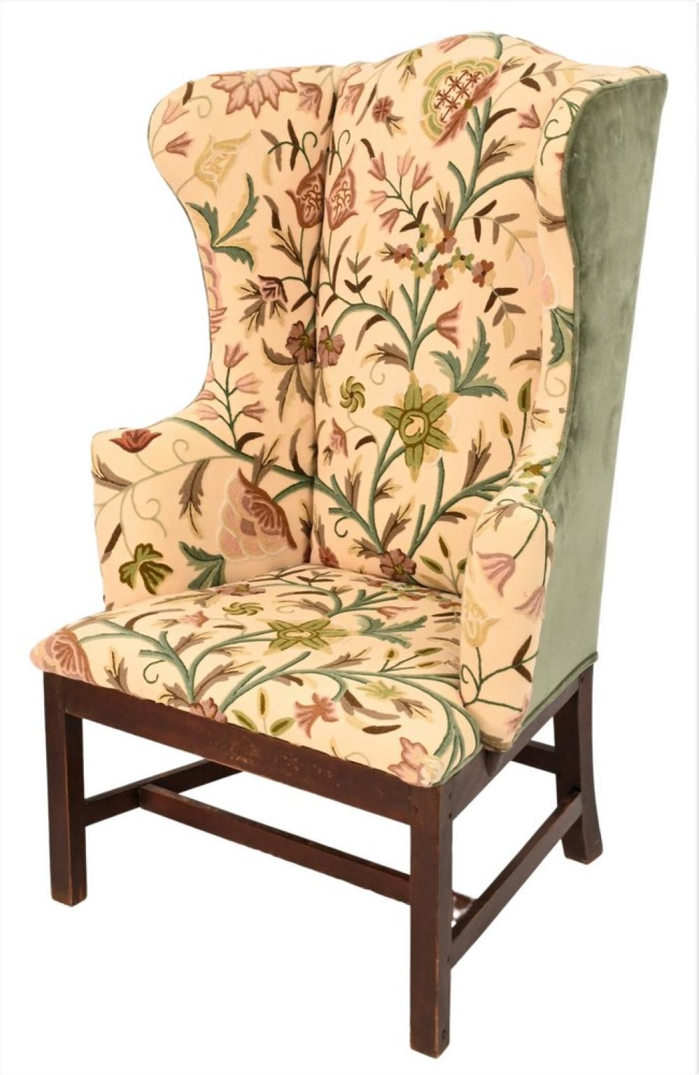 Chippendale Maple Upholstered Wing Chairin crewel work upholsteryset on base with squared legs with H stretchersheight 46 inches,...