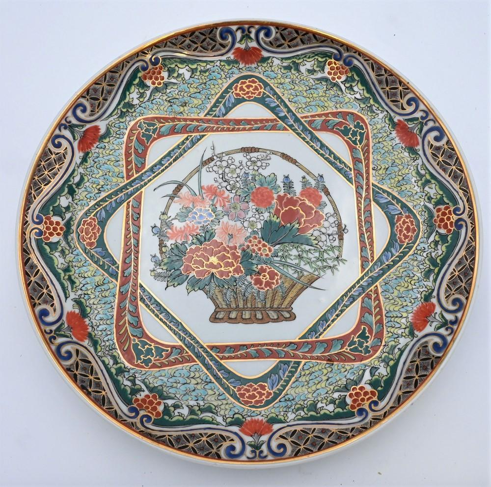 Large Chinese Famille Verte Porcelain Chargerhaving painted and enameled flowers in a basket, center with scrolling vines and flowe...
