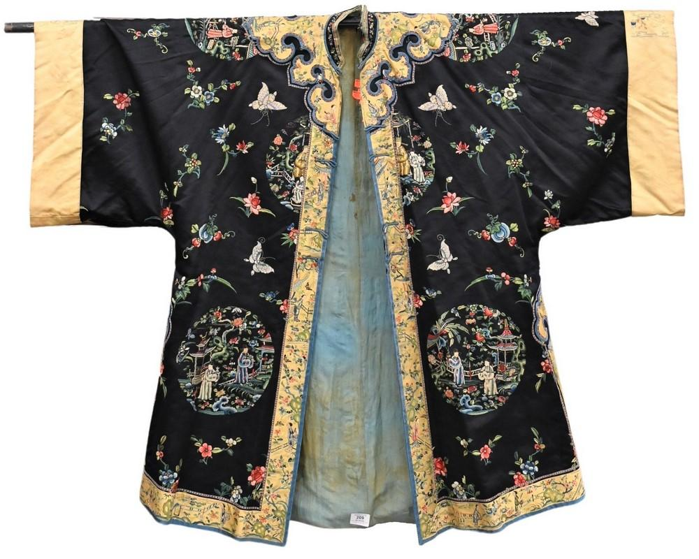 Chinese Silk Robedark blue ground, having embroidered panels of figures in a courtyard, butterflies and wild flowers