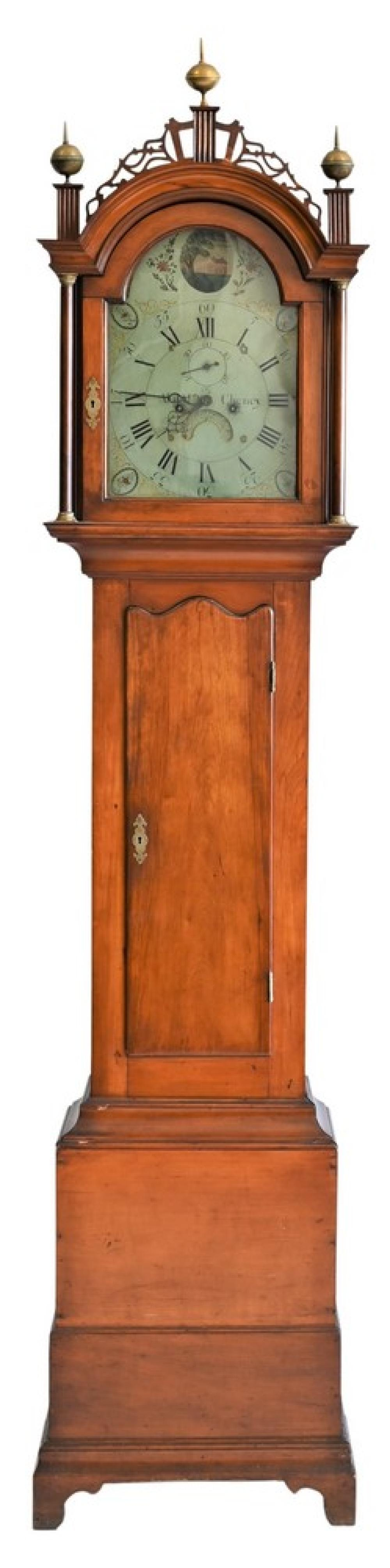 Asahel Cheney Tall Clockhaving fretwork top over tombstone door, over shaped top door, on base with bracket feet, painted metal dia...