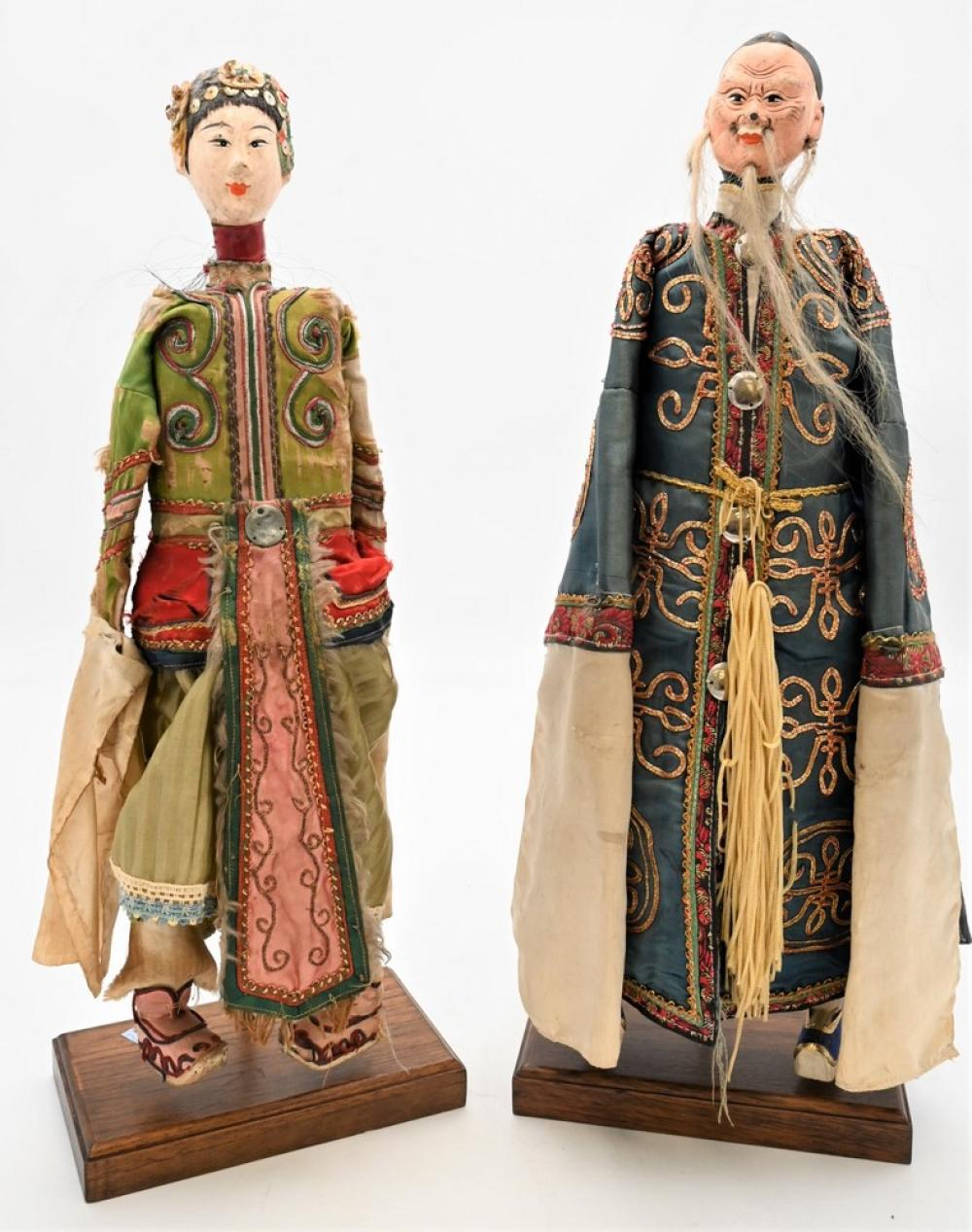 Pair of Chinese Wood Carved Doll Figuresscholar wearing a silk robe, and a guanyan with tattered silk robe, 19th centuryheight 19...