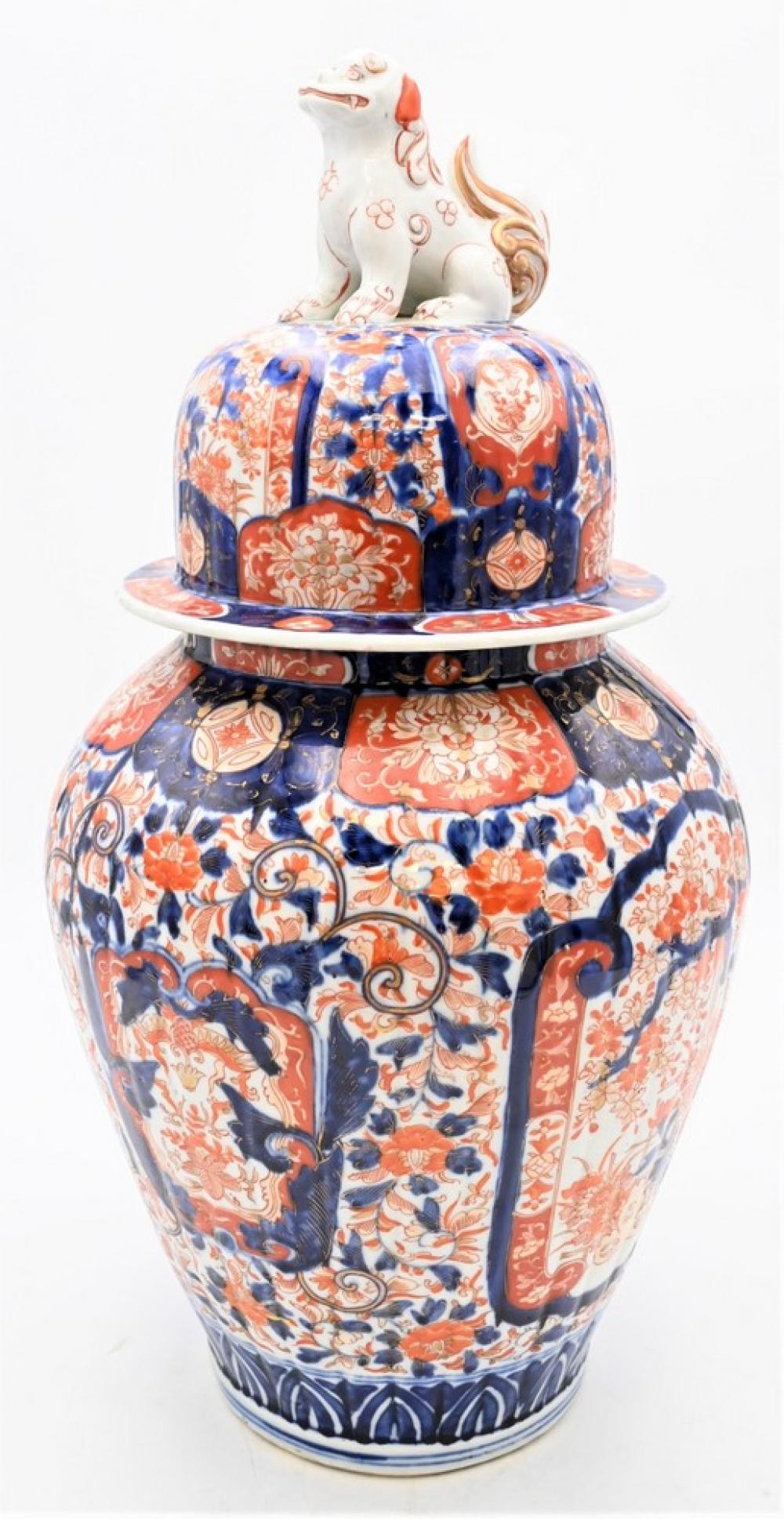 Large Japanese Imari Porcelain Jarhaving foo dog finial on dome shaped cover on baluster form vase, painted with garden scenesheig...