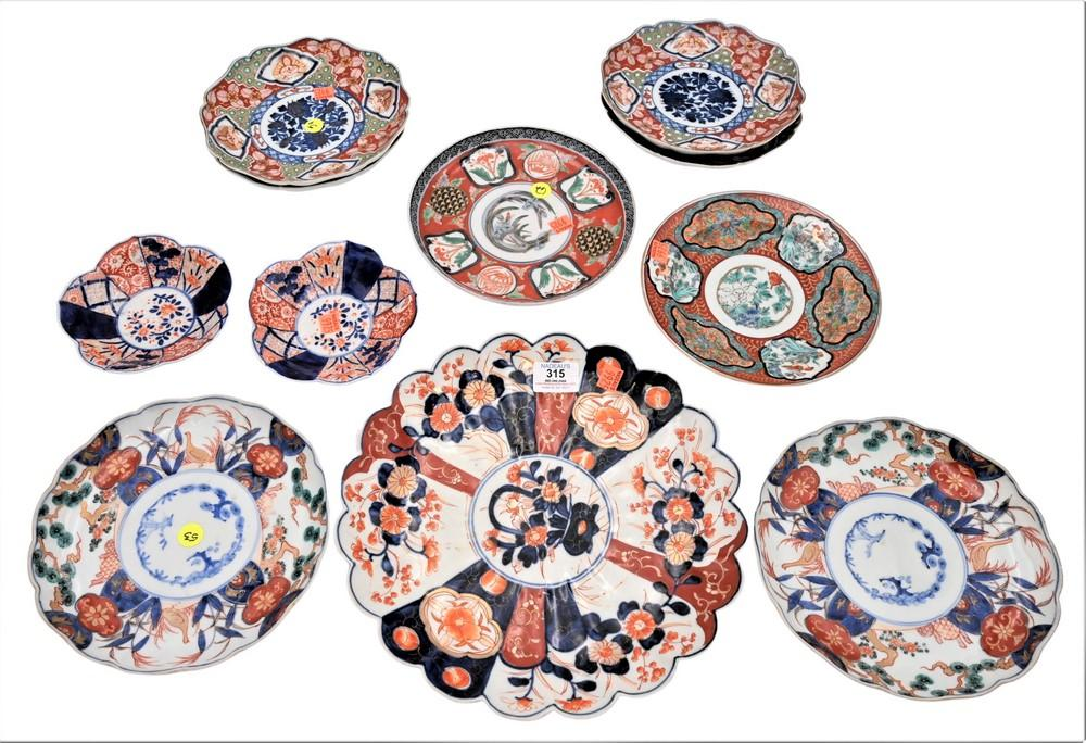Group of 11 Imari Porcelain Dishesto include a set of 4 plates, signed on bottomdiameter 8 3/8 inches; charger having scallop edge...