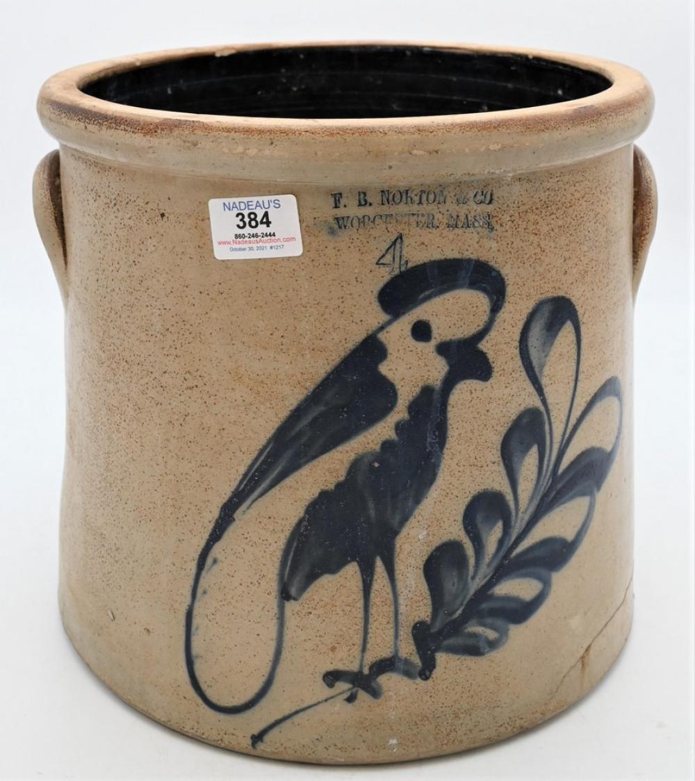 F.B. Norton, Worcester, Mass. Stoneware Crockhaving two handles and blue bird on leafy branchheight 11 1/4 inchesProvenance: Esta...