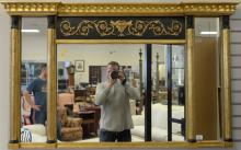 Federal style three part mirror, gilt and black painted with Pharaoh busts. 35