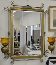 Large Victorian brass framed mirror having mounted oil lamp sconces with glass shades. ht. 49in., wd. 37in. plus adjustable arms.