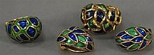 14K gold and enameled four piece lot to include two rings and a pair of earrings. 46.4 grams