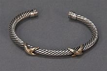 David Yurman silver single twist bracelet mounted with two 14k gold X's, signed David Yurman.