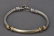 David Yurman  silver twist bracelet with 14k gold long link having hook clip, signed David Yurman.