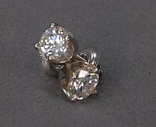 Pair of diamond stud earrings set in white gold, each approximately 1cts.