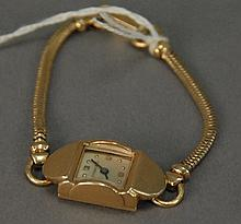 Tiffany 14K gold ladies wristwatch and band, 19.5 grams total weight.