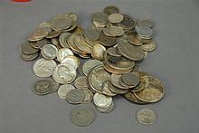 Jar of coins, mostly silver including silver dollars, half dollars, quarters, nickels, and dimes.