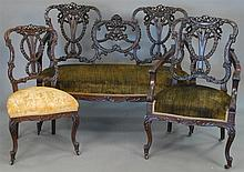 Three piece set to include mahogany settee, armchair, and side chair, all with upholstered seats, settee: lg. 53in.