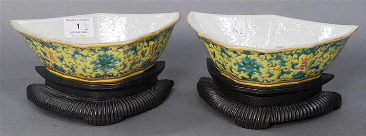 Pair of Famille verte yellow ground porcelain dishes on carved stands, red under glaze Qianlong mark on bottom, painted in gilding, ...