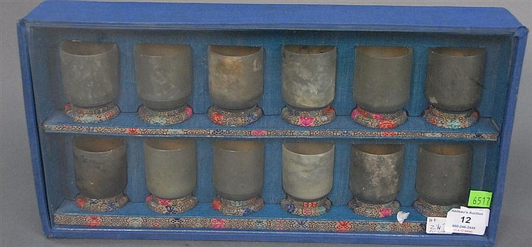 Set of twelve jade cups on stands in fitted box, each cup ht. 2 1/4in.