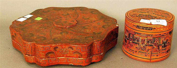 Two red lacquered boxes, seven section covered box with black removable tray section ht. 3in.; dia. 12in. and picnic box with lacque...