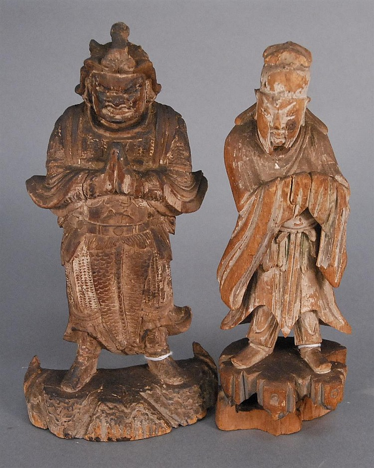Two carved wood figures; one carved in the form of a scholar wearing a robe ht. 10 1/2in. and the other carved in the form of a warr...