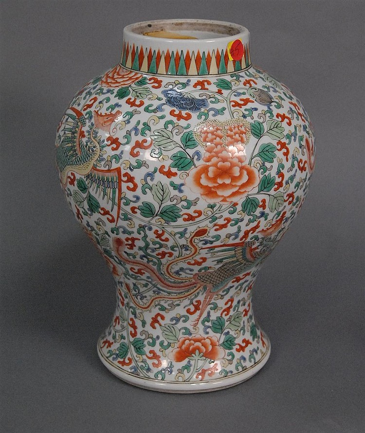 Large Famille rose vase with an overall scrolling flower and vine design with large fly cranes, ht. 13in.