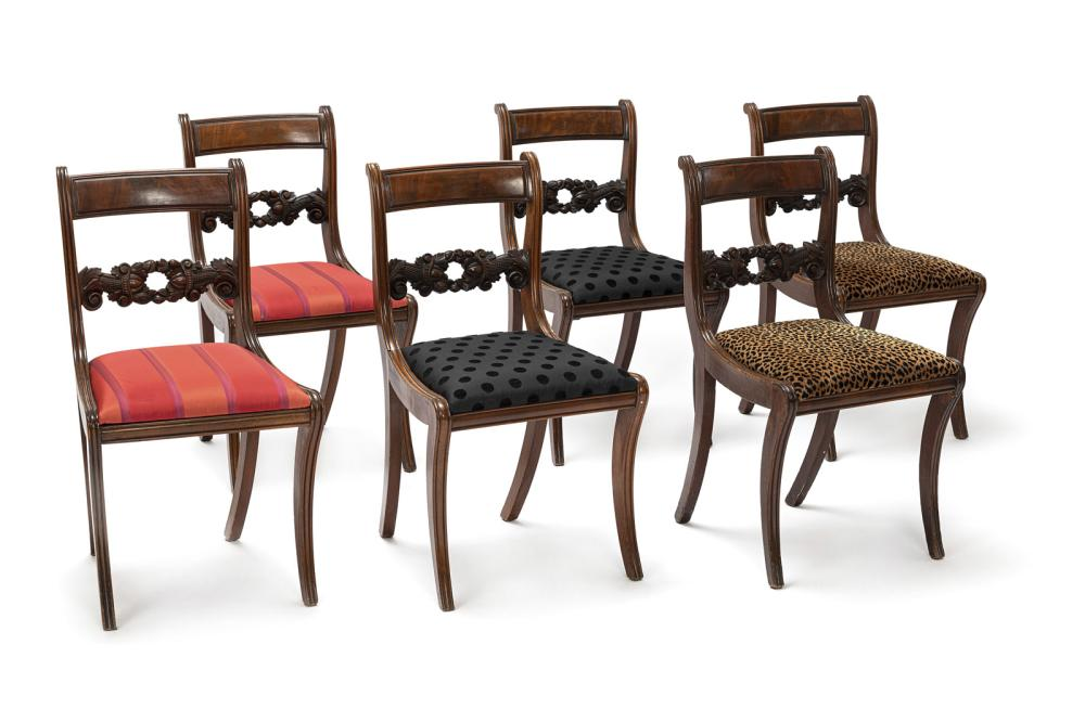 A SERIES OF SIX FRUIT TOOLED MAHOGANY CHAIRS