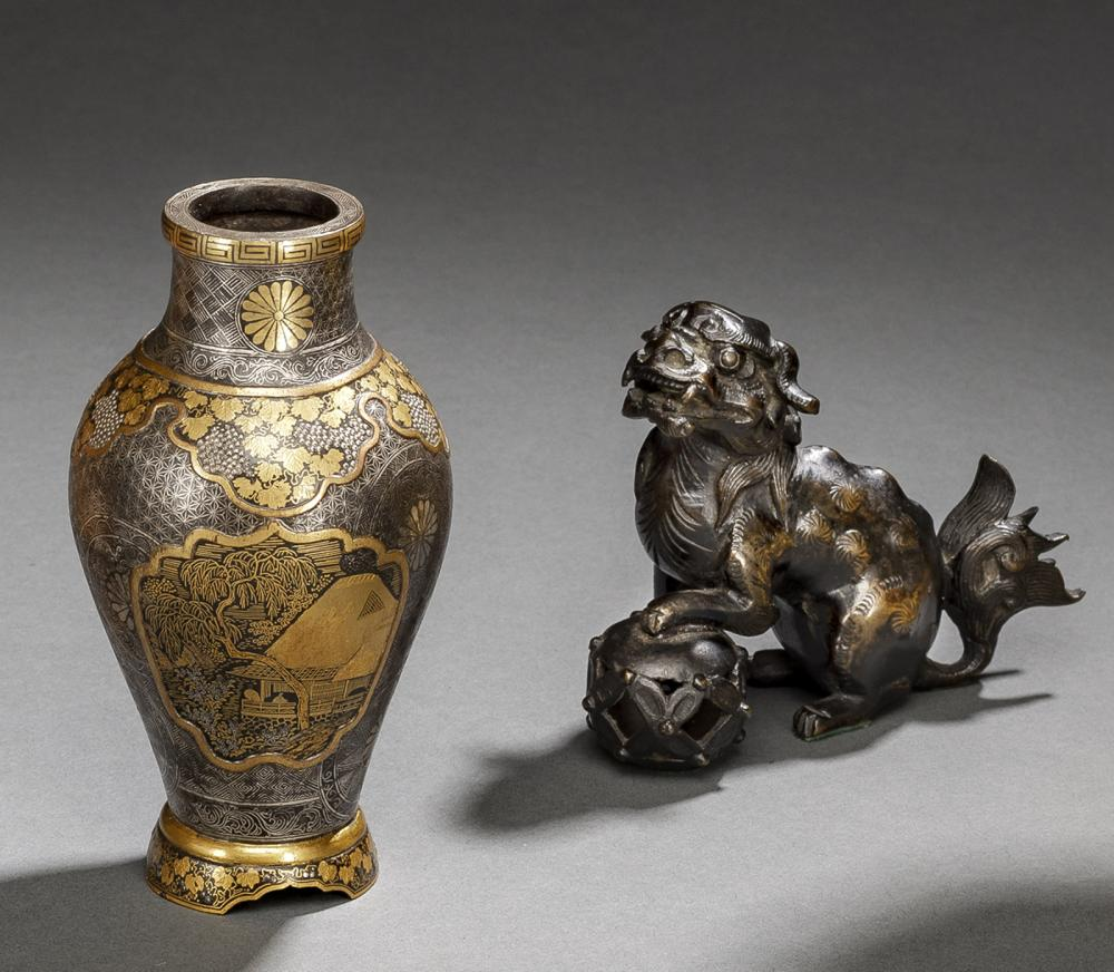 A GOLD- AND SILVER DECORATED KOMAI STYLE IRON VASE AND A BRONZE SHISHI