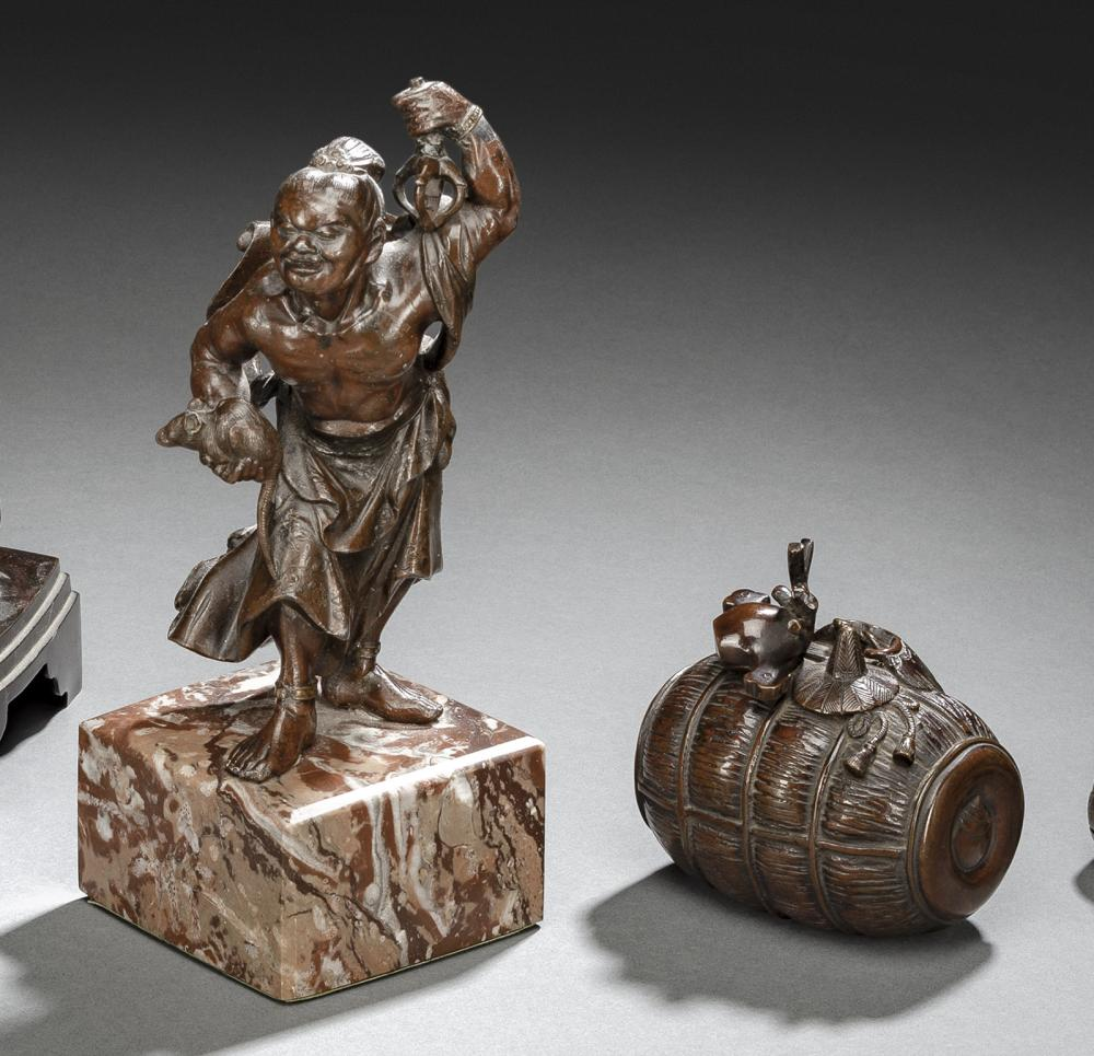 A BRONZE FIGURE OF A NIÔ AND A BOX AND COVER IN SHAPE OF A STRAW BALE