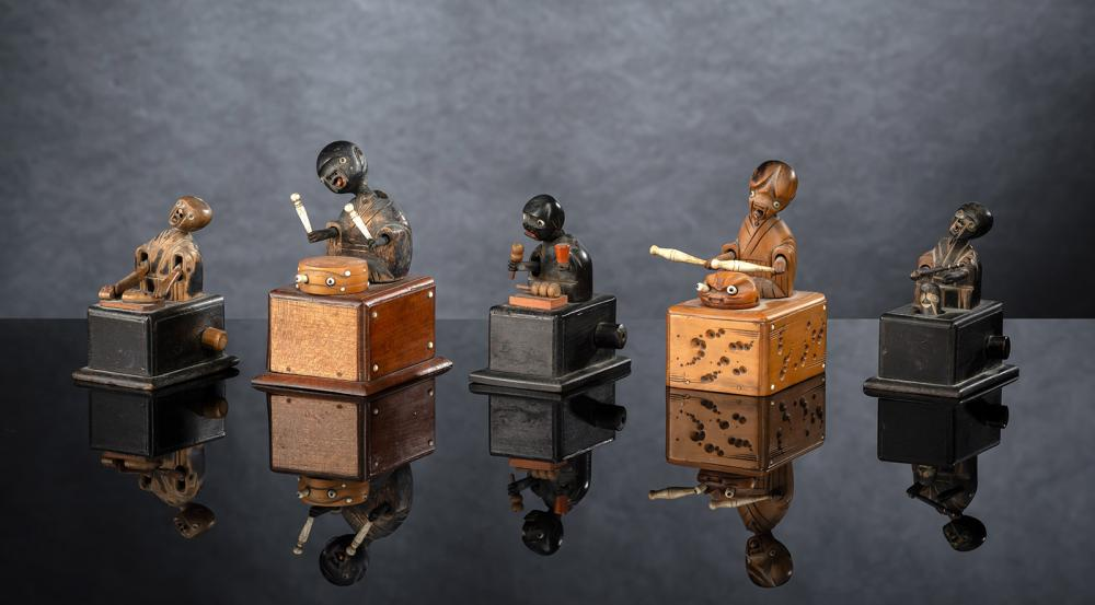 A GROUP OF FIVE JAPANESE WOOD KOBE TOYS