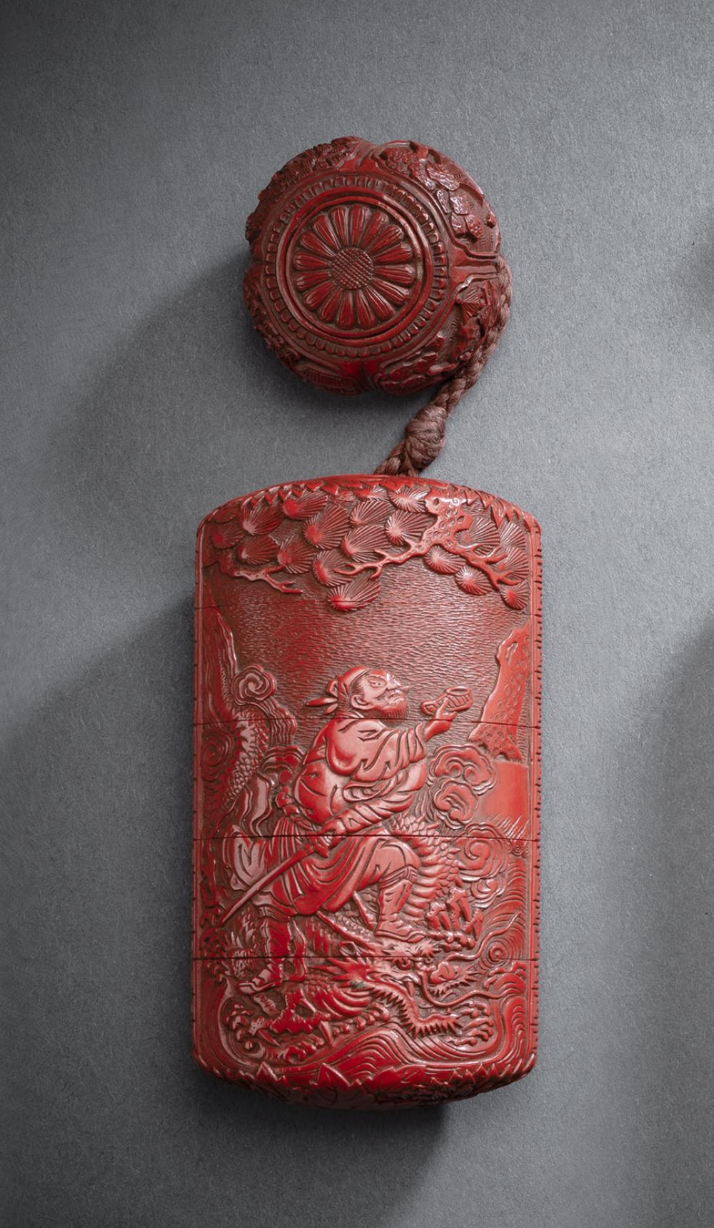 A FOUR-CASE RED LACQUER INRO DEPICTING A SCENE WITH CHÔRYO AND KOSEKIKO AND A MANJU DECORATED WITH LANDSCAPE SCENES
