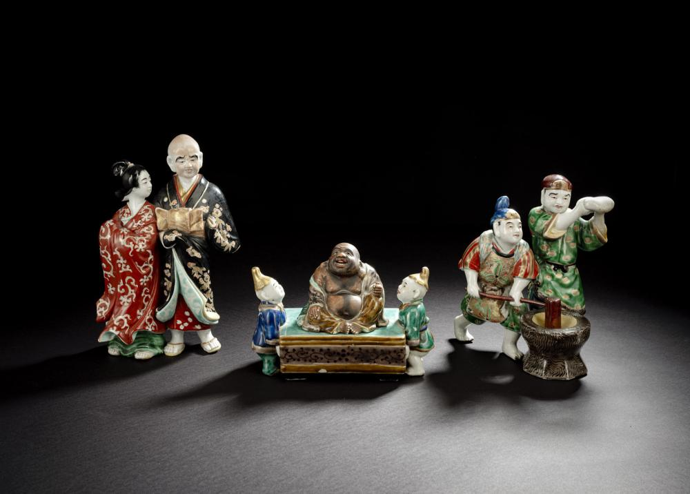 THREE POLYCHROME PAINTED PORCELAIN FIGURES