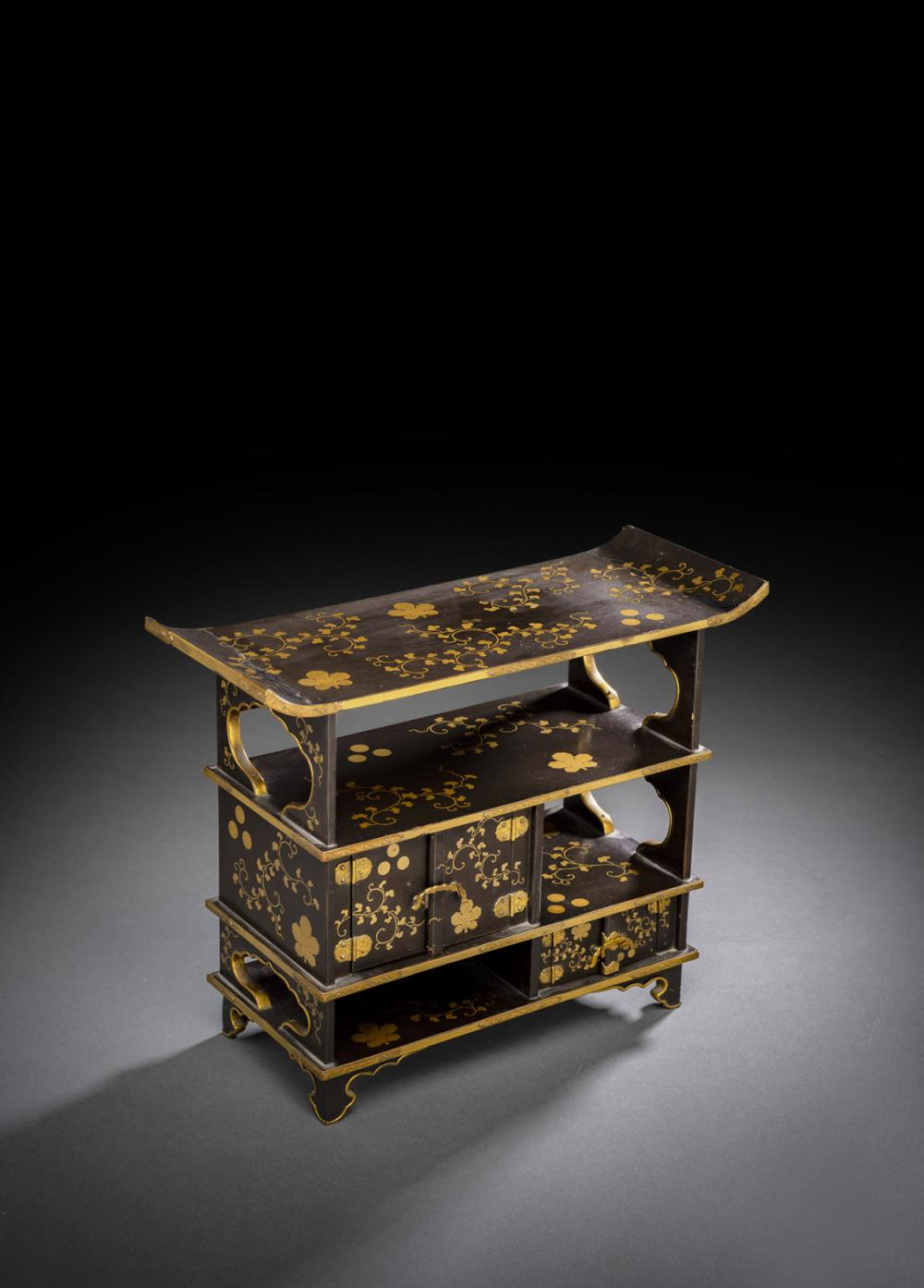 A SMALL GOLD-INLAID LACQUER CABINET