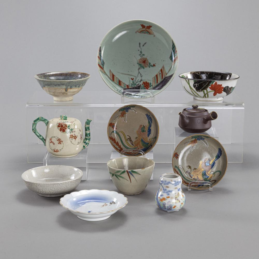 A GROUP OF ELEVEN PIECES OF PORCELAIN, INCLUDING BOWLS, TEAPOTS, VASES O.A.