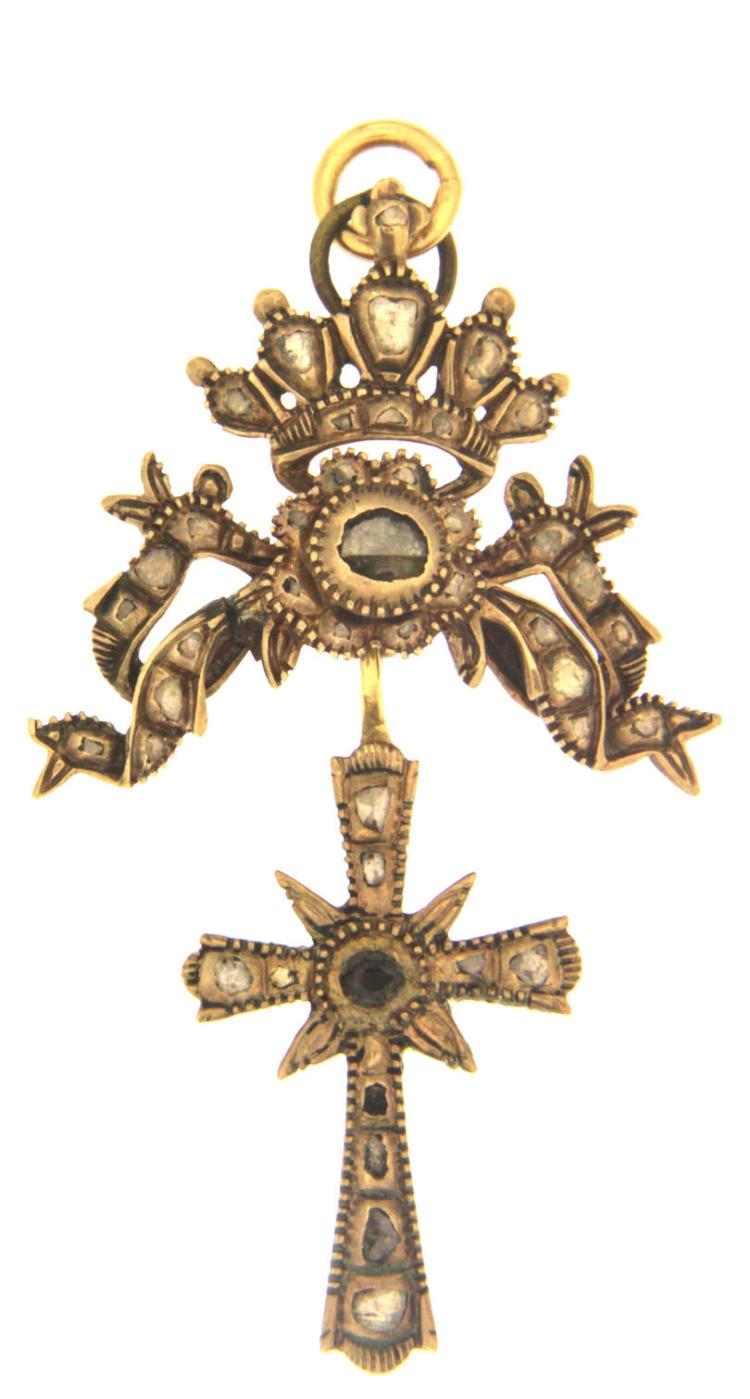 An early 19th century 9k gold cross pendant with rough diamonds