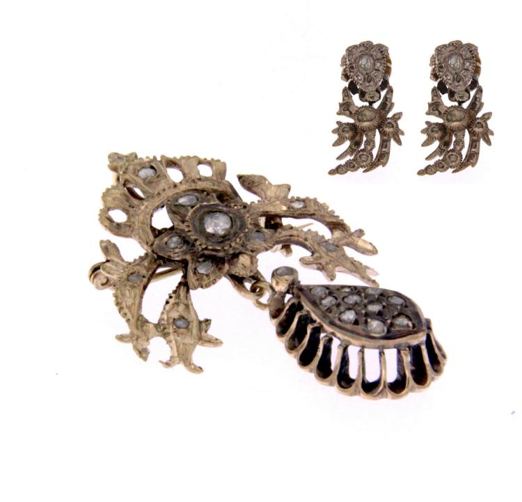 An antique 9k gold pendant / brooch and earrings set with rough diamonds .