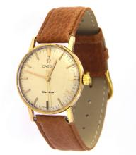 An 18k yellow gold watch OMEGA Geneve automatic n.14786 62 with leather strap.