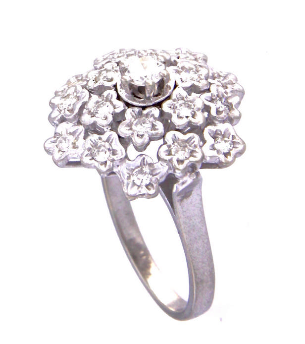 An 18k white gold diamond cluster ring