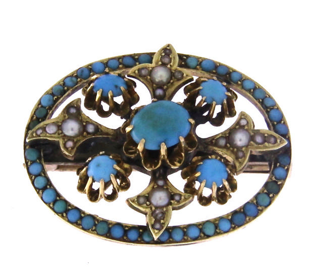 An antique 14k yellow gold brooch with turquoise and seed pearls.