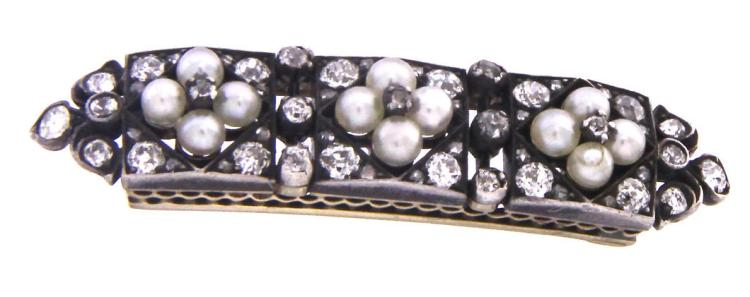 An antique 9k white gold brooch with rose cut diamond and pearls  .