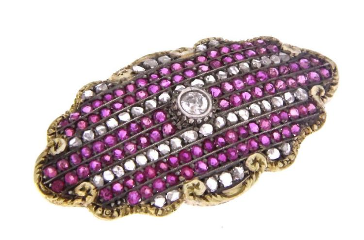 An antique 18k yellow gold brooch with diamonds and rubies