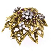 A two color 18k gold BOUCHERON rubies and diamonds brooch