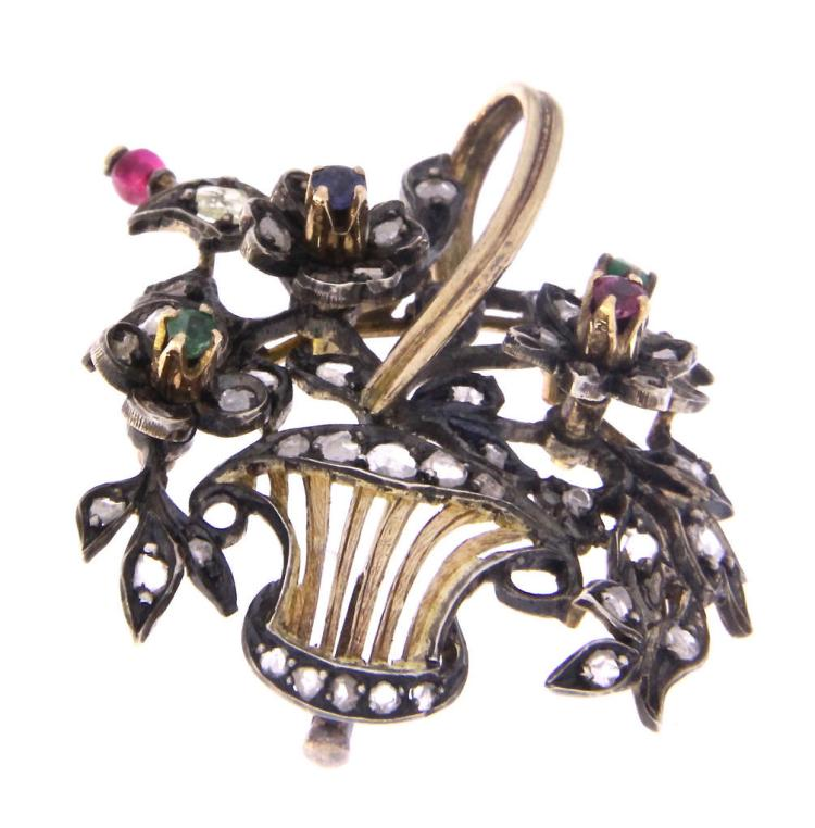An antique 18k yellow gold brooch with sapphire, rubies, emeralds and rose cut diamonds.