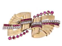 An amazing art deco 18k gold brooch with rubies and diamonds divisible into two brooches.    An
