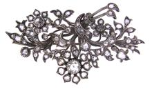 An antique 9k white gold large brooch with rose cut diamonds.