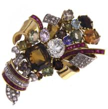 An 18k two-color gold spray brooch with colored stones, diamonds and rubies