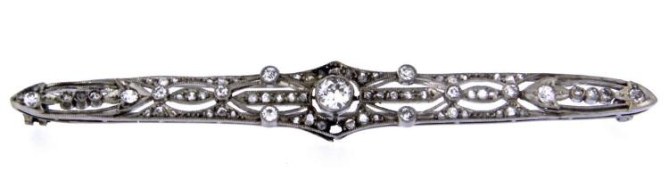 An 18k white gold art Deco' filigree bar pin with diamonds